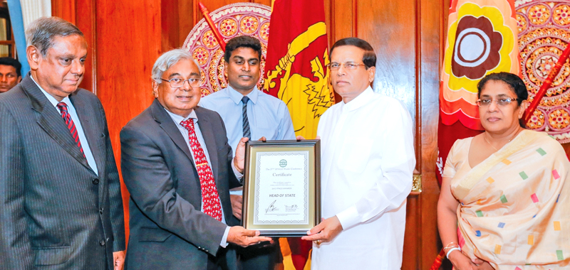 President Maithripala Sirisena receiving the award. Picture by Sudath Silva.