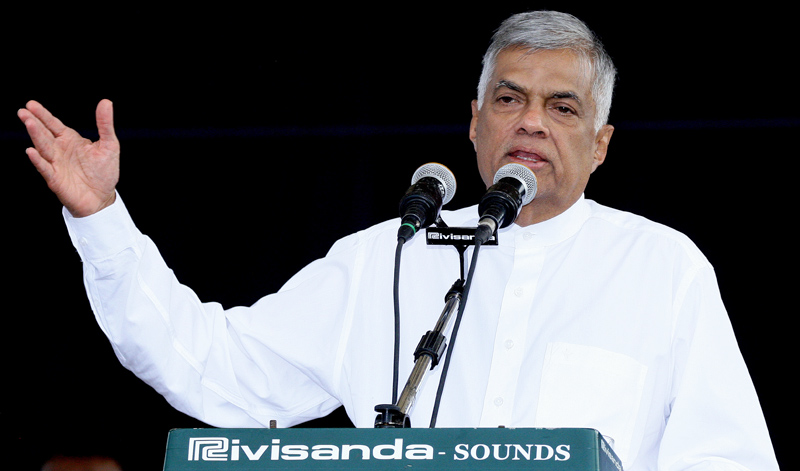 Prime Minister Ranil Wickremesinghe addressing a United National Party rally in Gampaha yesterday. Pictures by Hirantha Gunathilaka