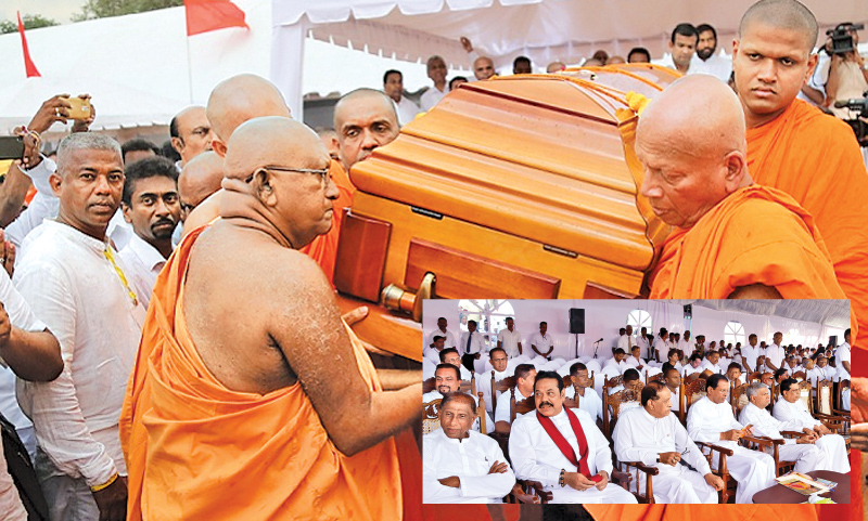 The cremation of Ven. Prof. Bellanwila Wimalarathana Anunayake Thera took place at the Sri Jayawardenapura University grounds amidst a large gathering of the Maha Sangha, members of academia and politicians. Picture shows the Maha Sangha led by Chief Incumbent of the Bellanwila Rajama Viharaya and Chief Sangha Nayake of Singapore Ven. Bellanwila Dhammarathana Thera carrying the casket bearing the remains of the late Thera to be placed in the Chithakaya. (Bottom) President Maithripala Sirisena, Prime Ministe