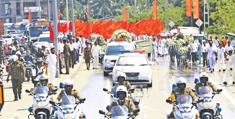 The vehicle procession carrying the casket.