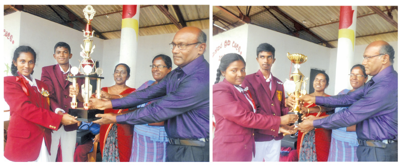 Kumarana House captains receiving the championship cup from Principal, Vice Principal and sports teacher at the closing ceremony of Pothupitiya MV sportmeet.-Rahula House captains receiving the runner-up cup.    Picture by Kalutara Central Special Corr. H.L. Sunil Shantha