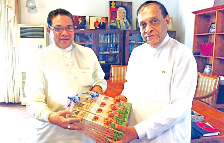 Sumedha Elpitiya is seen handing over the product to Speaker  Karu Jayasuriya.