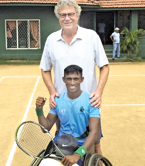 Champion D S R Dharmasena with national wheelchair tennis coach, Aad Zwan of Netherland celebrating his victory at the Negombo courts.