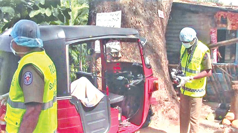 Police inspecting the crime scene. Picture by Siri Abayasiri, Matale Central Group Corr.