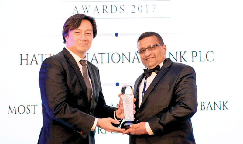 HNB Senior Manager - Development Banking Vishwanath Gunawardena accepting the award for Most Innovative Microfinance Bank in Sri Lanka at the recently concluded International Finance Magazine Awards (IFM) 2017 in Singapore.