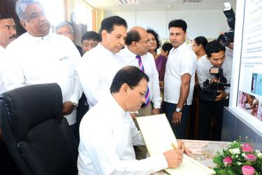 President Maithripala Sirisena signs the visitors' book after opening the new National Dental Teaching Hospital in Colombo yesterday while Health Minister Dr. Rajitha Senaratne and Deputy Health Minister Fizal Kassim look on.