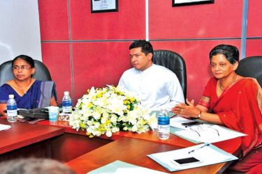 International Trade State Minister Sujeewa Senasinghe and members of the NES consultative team.
