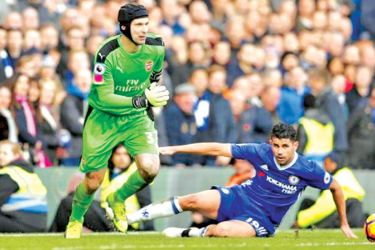 Arsenal's Petr Cech in action with Chelsea's Diego Costa in their English Premier League match at Stamford Bridge.