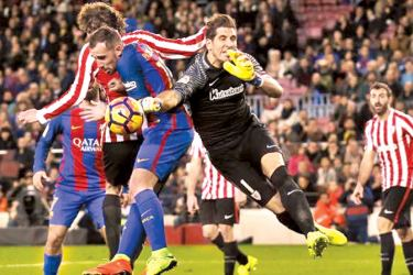 Athletic Bilbao's goalkeeper Gorka Iraizoz and Barcelona's Paco Alcacer in action in their Spanish La Liga Santander match at Camp Nou stadium, Barcelona.