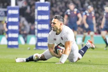 England's Ben Te'o celebrates scoring their first try in the opening Six Nations rugby match against France at Twickenham Stadium Saturday.