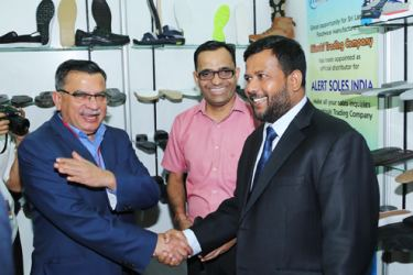 Minister of Industry and Commerce, Rishad Bathiudeen greets President of Indian Footwear Components Manufacturers Association (IFCOMA), Vipan Seth at the ninth Footwear and Leather Fair 2017 at BMICH.