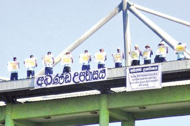 The employees on the rooftop in protest Picture by Sigiriya Special Corr.
