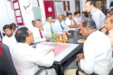 Health Minister Dr. Rajitha Senaratne in conversation with officials of Western Province Health Ministry and Kalutara District Secretariat.