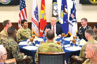 US President Donald Trump sits down for lunch with troops during a visit to the US Central Command at MacDill Air Force Base  in Tampa, Florida on Monday. - AFP