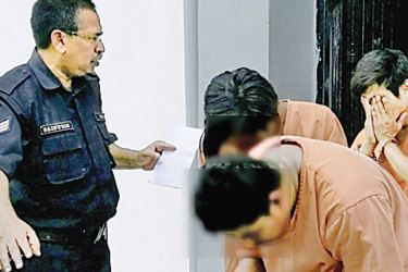The two foreigners were detained to facilitate the murder of a Sri Lankan man at an estate off Jalan Sidam Kiri.
