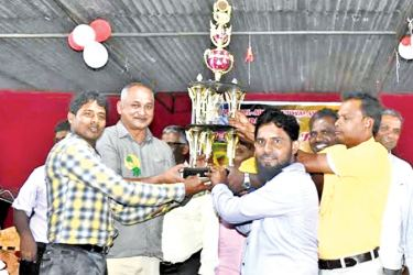 Jesmin House captain receiving the trophy from Eastern Province Health Minister A.L.M. Nazeer. Picture by I.L.M. RIZAN