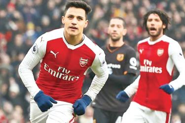 Arsenal's Alexis Sanchez celebrates scoring their second goal against Hull City in the Premier League match at Emirates Stadium on Saturday.