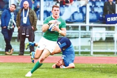 Ireland's Craig Gilroy scores a try in the Six Nation match against Italy at Rome on Saturday.