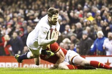 England's Elliot Daly scores a try in their Six-Nations rugby international against Wales at Cardiff on Saturday.