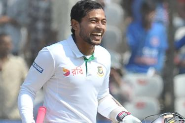 Bangladesh's captain Mushfiqur Rahim celebrates after scoring century (100 runs) on the fourth day of a solo Test match between India and Bangladesh at the Rajiv Gandhi International Cricket Stadium  on February 12. AFP
