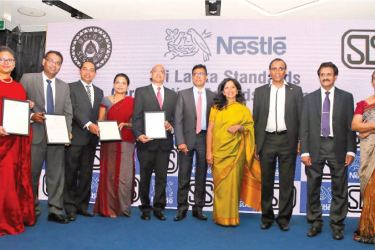 The SLS Certification Award recipients,  Shivani Hegde, Managing Director for Nestle' with the four awards Picture by Saliya Rupasinghe