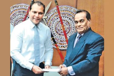 Here Milton Amarasinghe receives his letter of appointment from Sports Minister Dayasiri Jayasekara