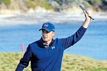 Jordan Spieth reacts after a birdie on the 17th green during the Final Round of the AT&T Pebble Beach Pro-Am at Pebble Beach Golf Links on February 12, 2017 in Pebble Beach, California. AFP