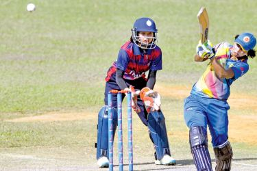 Sri Lanka Women cricketer Chamari Polgampola drives for runs in the ICC Women's World Cup qualifier match against Thailand at MCA grounds yesterday. Picture by Rukmal Gamage