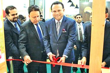 Plantation Industries Minister Navin Dissanayake, Rohan Pethiyagoda, Chairman of the Sri Lanka Tea Board, and Dr. Saman Weerasinghe, Ambassador of Sri Lanka to Russia at the opening.