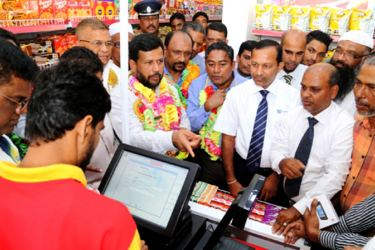 Minister of Industry and Commerce Rishad Bathiudeen at the opening event of the 325th Lanka Sathosa outlet in Muthur.