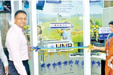 HNB Deputy General Manager Retail and SME Banking, Thimal Perera, opening the new customer centre.  Asiri Surgical Hospital Director Operations, Dr. Samanthi De Silva, Medical Director, Dr Harsha Baranage and HNB Assistant General Manager Network Management, Nirosh Perera look on.