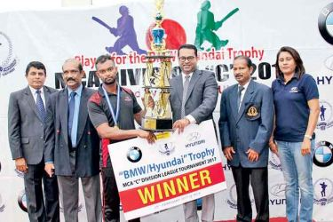 "Commercial Credit & Finance 'B' captain Praneeth Wijesena  (3rd from left) receiving the "" BMW/Hyundai""  Trophy from the Chief Guest,  Director Sales,  Prestige Automobile (Pvt) Ltd.,  Niranga Peiris  (3rd from right). Others in the picture from left : Sujeewa de Silva, Chairman Tournament Committee /MCA,  Nalin Wickremesinghe , General Secretary MCA,   HUU Buddhima, Vice President /MCA  &  Tharanga Vithanage, Head of Sales, Hyundai Lanka (Pvt) Ltd."