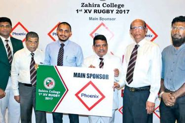 General Manager, Marketing of Phoenix Industries Ltd Rimaz Marzook (3rd from left) presents the main sponsorship to Principal of Zahira College, Trizvi Marikkar. Others in the picture from left are M. Azhar Irfan, Captain - Zahira College 1 st XV Rugby Team, M.S. Mazeer – Chairman, Sports Council, Riza Abdeen – Chairman, Rugby Committee and Shamlie Nawaz – Head Coach/Consultant, Zahira Rugby.