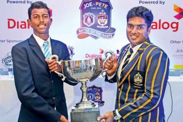 Joes captain Hareen Cooray (left) and Peterite skipper Lakshina Rodrigo holding the Rev. Fr Maurice Legoc trophy.