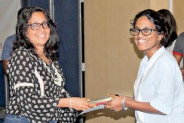 Natasha Fernando representing Neo Ogilvy receiving the award from Krishanthi De Silva, Joint Managing Director, Rocco's.