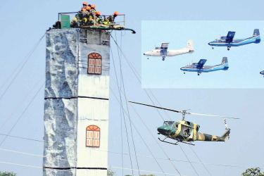 Sri Lanka Air Force fire fighters carrying out a fire drill to mark the SLAF's 66th Anniversary at Ratmalana Airport yesterday. Pictures by Chaminda Niroshana