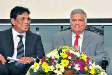 """Prime Minister Ranil Wickremesinghe who was the Chief Guest at the ceremonial inauguration of """"National Law Week 2017"""" at the BASL auditorium yesterday is seen in conversation with Chief Justice Priyasath Dep. Picture by Malan Karunaratne"""