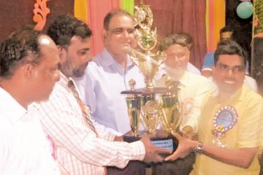 Sports Deputy Minister and SLMC Deputy Leader H.M.M.Harees handing over the champions trophy to the captain of Safa House