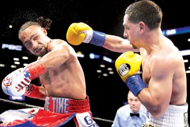 Keith Thurman and Danny Garcia exchange punches during their WBA/WBC Welterweight unification Championship bout at the Barclays Center in Brooklyn, New York on March 4, 2017 in New York City. -AFP