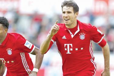 Bayern Munich's Javi Martinez of Spain celebrates his goal against FC Cologne with fellow team mate David Alaba of Austria in the German Bundesliga.