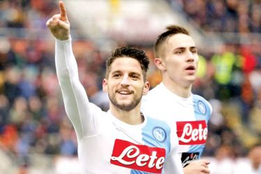 Napoli's Dries Mertens celebrates after scoring against AS Roma in the Italian Serie A at Olympic stadium.