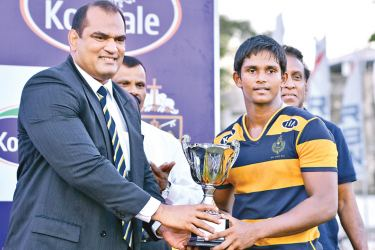 Old Peterite rugby player cum CH and FC second row forward Misver Deen who was the chief guest handing over the B.C. Anghie trophy to victorious Royal captain Ovin Askey.