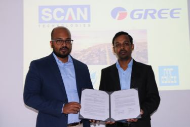 Pavithra Ishan Abeynayake, Managing Director of SCAN TECHNOLOGIES GLOBAL (PVT) LTD with Engineer, Raguparan Kobiraj after signing the agreements.