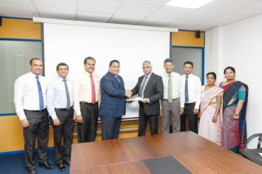 NITF CEO, Sanath C.De Silva, handing over the MoU to Hemas Hospital group Managing Director Dr. Lakith Peries flanked by NITF Chairman, Manjula De Silva, General Manager Marketing, Nishantha Jayamanna and head of operations, Prabhan Gunawardana.  Picture by Saliya Rupasinghe