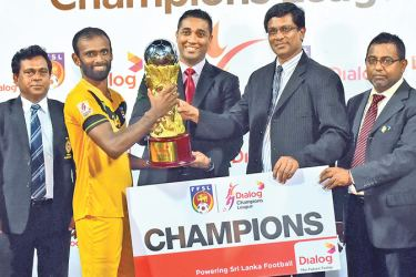 Colombo FC skipper, Rawme Mohideen receiving the Dialog Champions League trophy from Harsha Samaranayake, General Manager - Brand & Media, Group Marketing, Dialog Axiata PLC and Anura de Silva, President - FFSL. Balendra Anthony, Secretary - FFSL and Fazlan Sameem, Treasurer – FFSL are also present (below): Colombo FC champion team celebrate their victory.