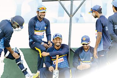 Sri Lanka players relax after a  training  session at the Galle International Stadium  yesterday. AFP