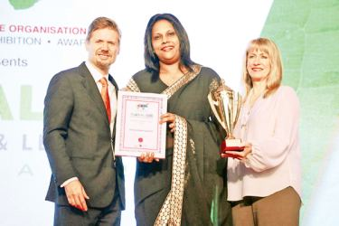 Commercial Bank's Manager Marketing, Irosha Weththasingha accepting the award on behalf of the bank.