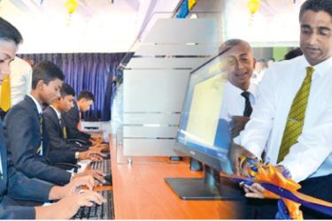 Dr. Dayan Rajapakse, Group Managing Director, ESOFT Group of Companies opening the new Computer Lab at the Kegalu Vidyalaya.  The Students at the Computer Lab.