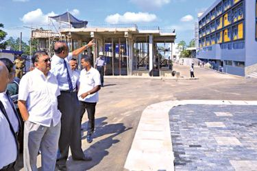 Minister Lakshman Kiriella inspecting the final phase of the construction of a new building complex