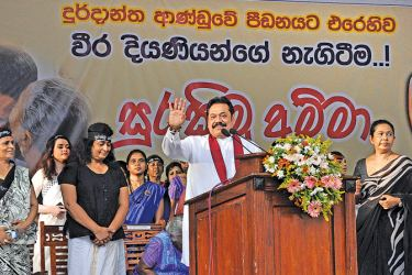 Former President Mahinda Rajapaksa with women representatives of the Joint Opposition on stage.  Picture by Rukmal Gamage
